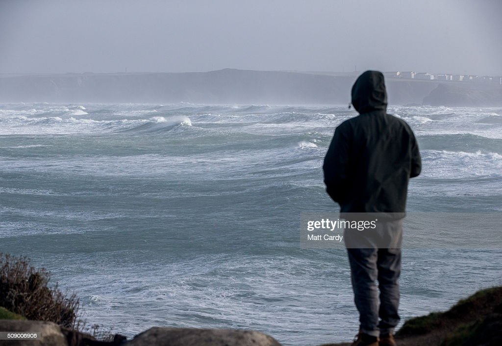 A man looks out to sea in Newquay on February 8, 2016 in Newquay, England. Parts of the UK are currently being battered by Storm Imogen, the ninth named storm to hit the UK this season. Thousands of homes have been left without power and commuters hit by road and rail chaos as Storm Imogen batters the South with gale force winds and torrential rain.