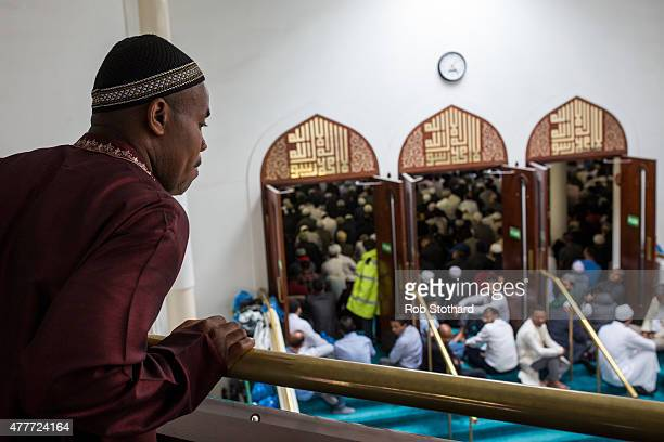 A man looks over a balcony inside the East London Mosque as people arrive to attend the first Friday prayers of the Islamic holy month of Ramadan on...