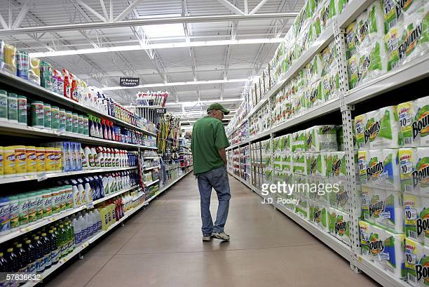 A man looks over items at the new 2000 square foot WalMart Supercenter store May 17 2006 in Bowling Green Ohio The new store one of three new...