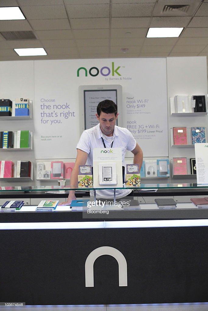 A man looks over Nook electronic book readers at a Barnes Noble store in New York US on Monday Aug 23 2010 Barnes Noble Inc the US bookstore chain...