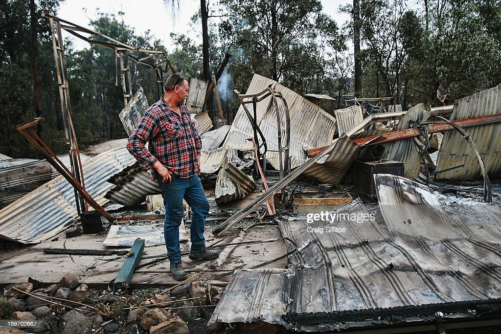 A man looks over the loss of his holiday home after a fire in the town of Seaton on January 19, 2013 in Melbourne, Australia. Bushfires in Victoria have claimed one life and destroyed several houses. Record heat continues to create extreme fire conditions throughout Australia.