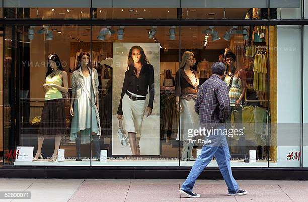 A man looks toward window mannequins as he walks past an HM clothing store April 7 2005 in downtown Chicago Illinois Europe's largest fashion...