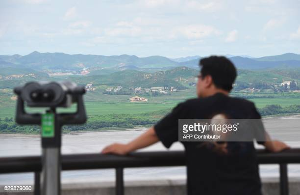 A man looks towards North Korea from a South Korean observation post in Paju near the Demilitarized Zone dividing two Koreas on August 11 2017 As...