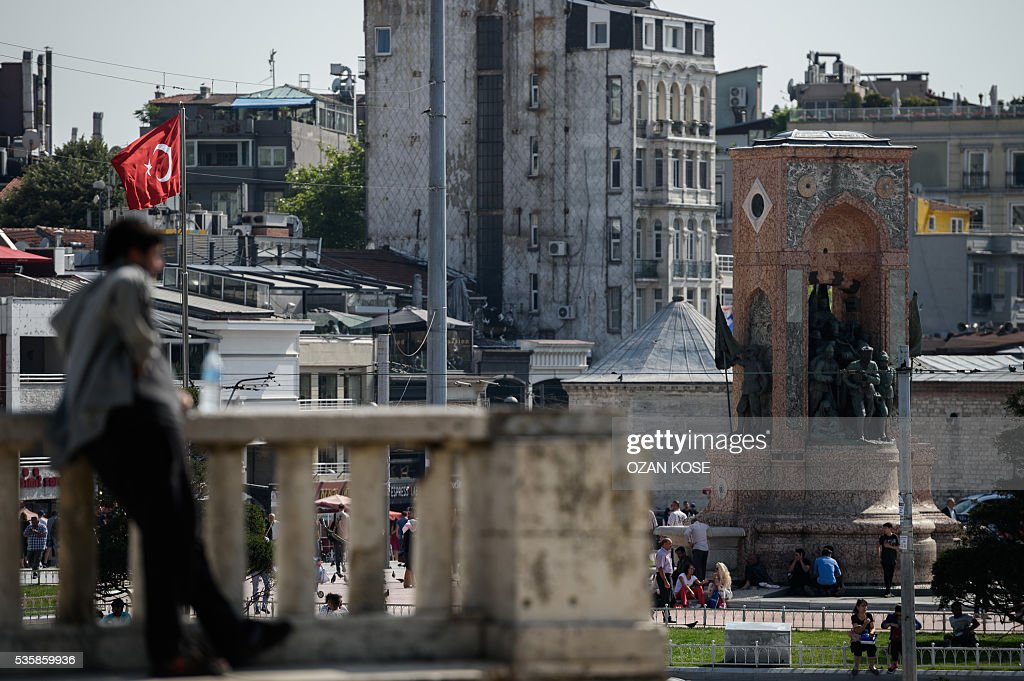 A man looks towards Taksim square from Gezi Park on May 30, 2016 on the eve of 3rd anniversary of the so-called Gezi Park protests. / AFP / OZAN