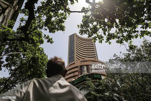 A man looks up at the Bombay Stock Exchange in Mumbai India on Tuesday Aug 5 2014 Indias benchmark stockindex fell as lenders declined after the...