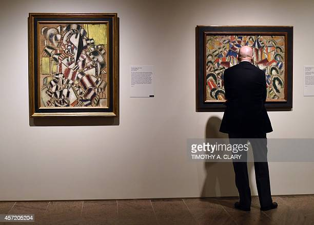 A man looks works by Fernand Léger during a press preview for 'Cubism The Leonard A Lauder Collection ' a major exhibition of the essential...