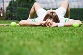Man lying down on tennis court
