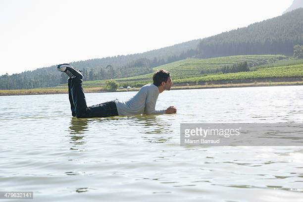 Man lying down on water