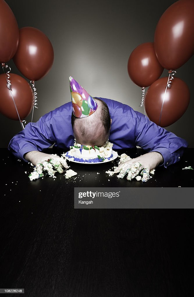 Man Lying Face First in Birthday Cake : Stock Photo