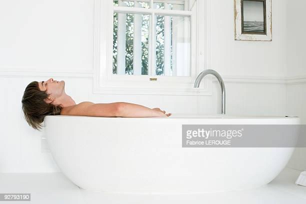 Man lying in a bathtub