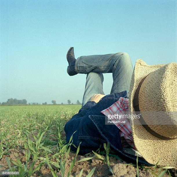 Man Lying in Field