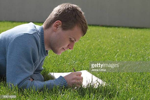 Man lying in grass