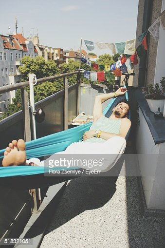 Laying in hammock stock photos and pictures getty images for Balcony hammock