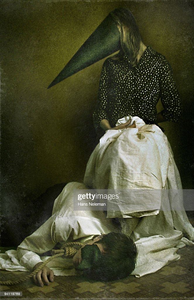 Man lying near a woman wearing a cone on her face, Lugansk, Ukraine : Stock Photo
