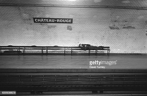 Man Lying on a Subway Bench