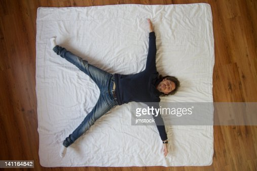 Man lying on floor : Stock Photo