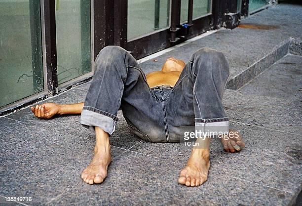 Man lying on street