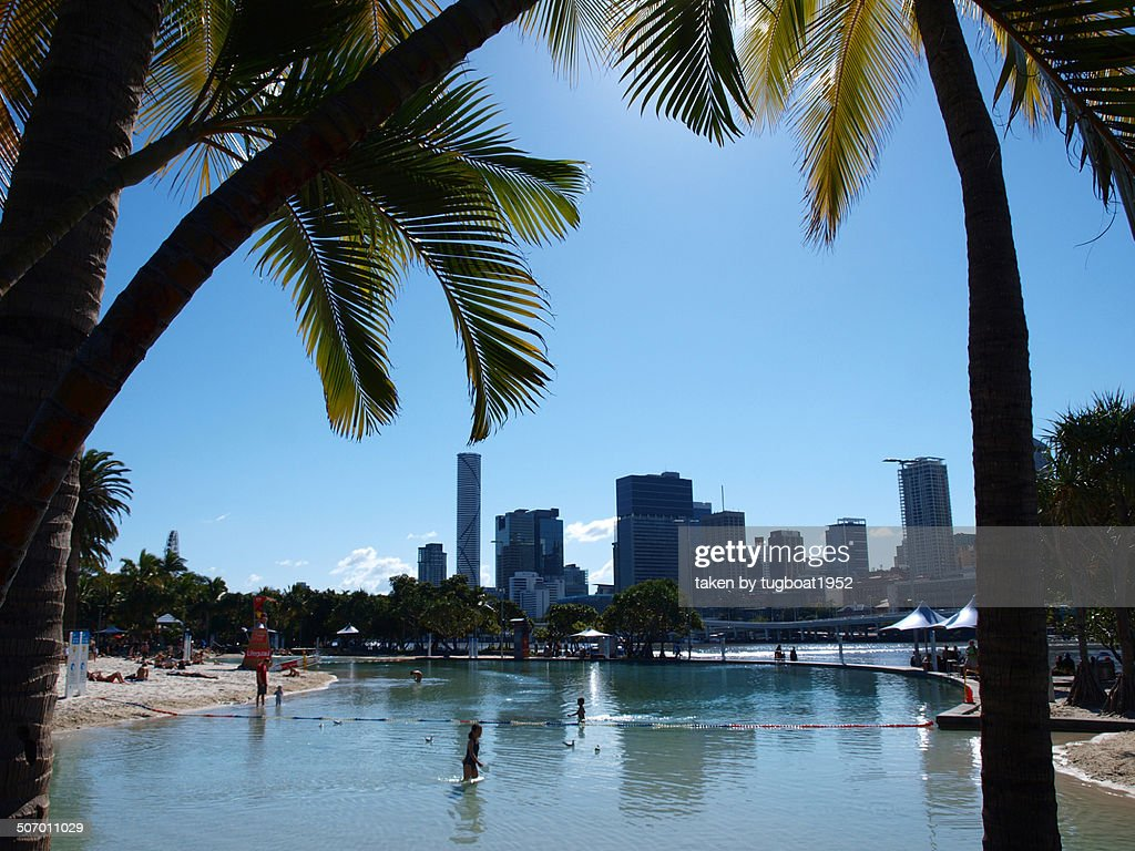 Man made beach and city view