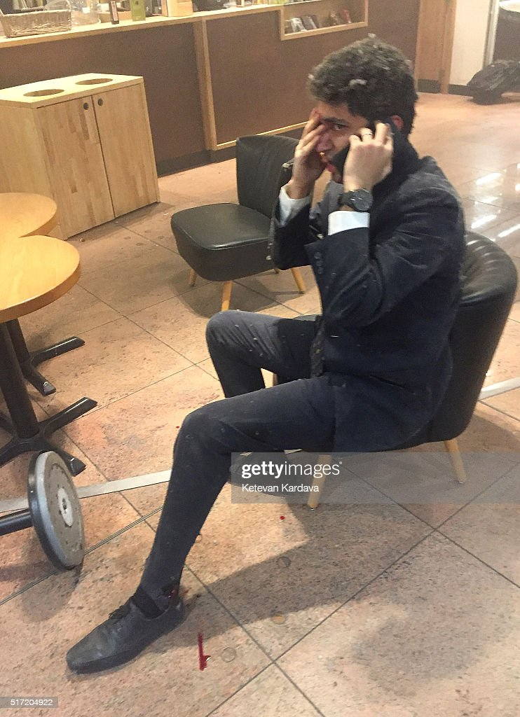 A man makes a phone call following a suicide bombing at Brussels Zaventem airport on March 22, 2016 in Brussels, Belgium. Georgian journalist Ketevan Kardava, special correspondent for the Georgian Public Broadcaster, was travelling to Geneva when the attack took place, she was knocked to the floor and began to take photographs in the moments that followed. At least 31 people were killed and more than 260 injured in a twin suicide blast at Zaventem Airport and a further bomb attack at Maelbeek Metro Station. Two brothers are thought to have carried out the attacks and a manhunt is underway for a third suspect.