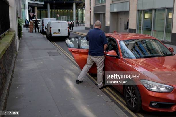 A man makes a quick toilet stop in a quiet side street in the City a quick pee in the Square Mile the capital's financial district on 3rd March 2017...