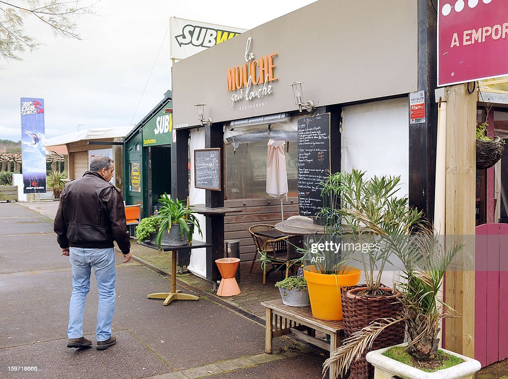 A man makes a stop on January 19, 2013 in Anglet, in southwestern France, in front of the restaurant 'La mouche qui louche', owned by French citizen Yann Desjeux, killed in the hostage rescue operation at a remote gas plant seized by Islamist militants in Algeria. Yann Desjeux, 52, was a former member of the French special forces at the 1st RPIMA in Bayonne, in southwestern France.