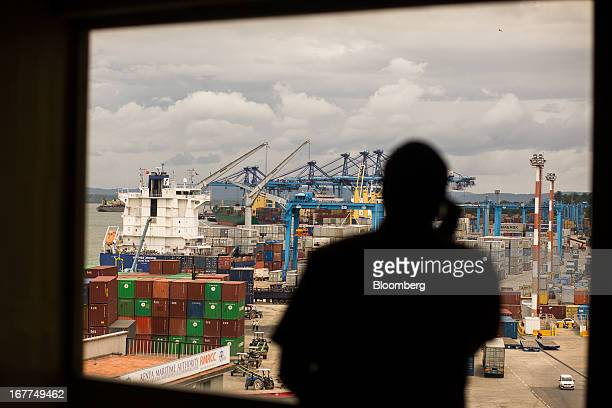 A man makes a telephone call from an office overlooking the ships in Mombasa port managed by Kenya Ports Authority a staterun company in Mombasa...
