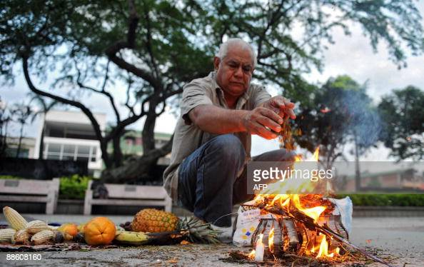 A man makes an offering during a ritual for the celebration of the 'Inti Raymi' on June 21 2009 in Cali department of Valle del Cauca Colombia The...