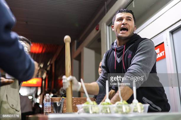 A man makes Arabic icecream during a street festival in the southwestern suburb of Lakemba on May 27 2017 in Sydney Australia Muslims around the...