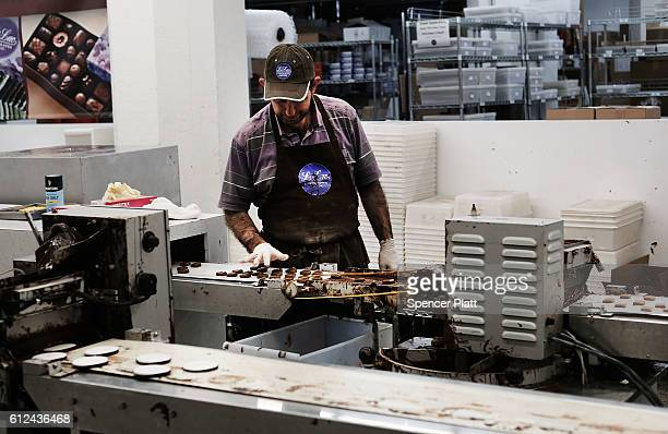 A man makes chocolate in a chocolate store in Industrial City a historic shipping warehousing and manufacturing complex on the waterfront in the...