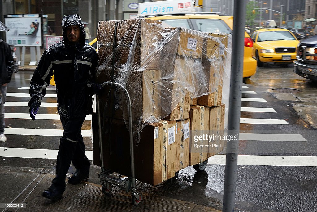 A man makes deliveries during a rain storm on May 8, 2013 in New York City. After experiencing an unusually dry spring in recent weeks, New York was hit with heavy rain Wednesday that resulted in numerous flash floods and heavy downpours.