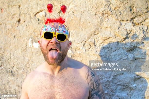 Man makes fun very happy celebrating his birthday