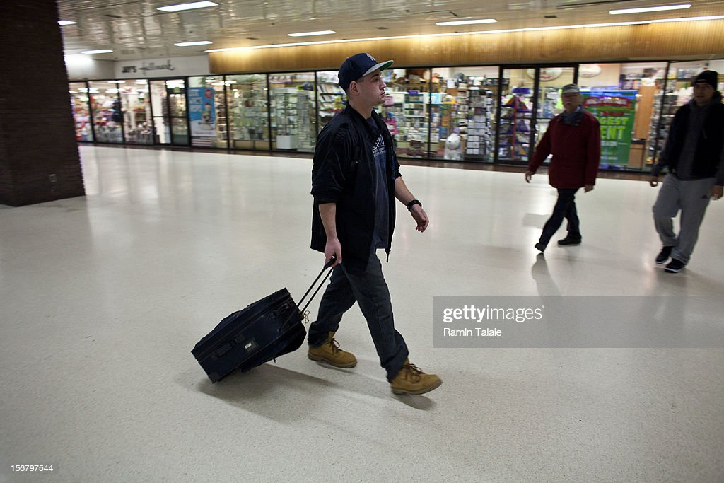A man makes his way through the New York Port Authority bus terminal in Manhattan on November 21, 2012 in New York City. The Port Authority of New York and New Jersey is expecting to handle a high number of travelers at its hubs, bridges, and tunnels ahead of the Thanksgiving holiday.