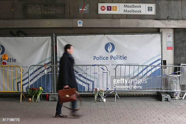 A man makes his way to work past the closed Maelbeek subway station on March 24 2016 in Brussels Belgium Belgium is observing three days of national...