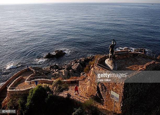 A man makes his way up to a view point on August 18 2008 in Lloret de Mar Spain Feeling the pinch from the credit crunch many British tourists to the...