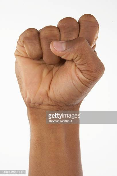 Man making a fist (focus on hand)