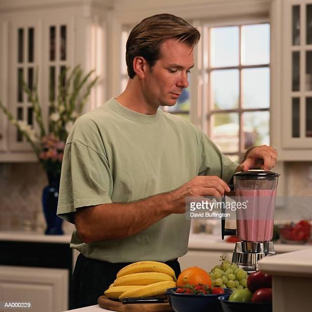 Man Making a Fruit Drink in a Blender