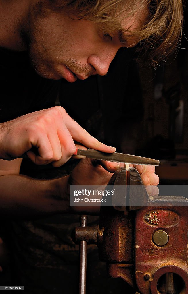 Man making a guitar