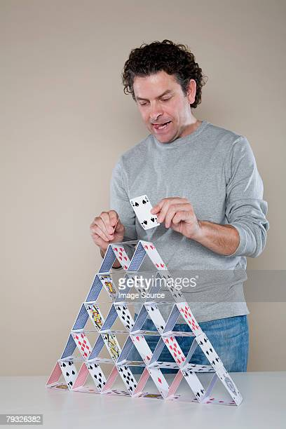 Man making a house of cards
