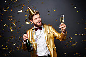 Man making a toast to new year