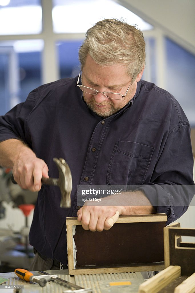 Man making a wooden toy truck. : Stock Photo