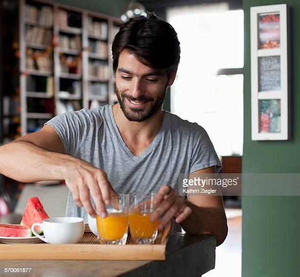 man making breakfast for two