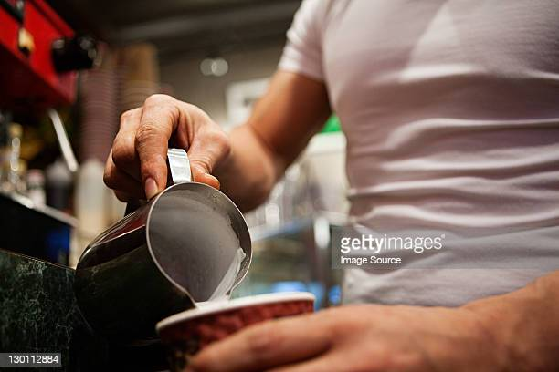 Man making coffee in cafe, close up