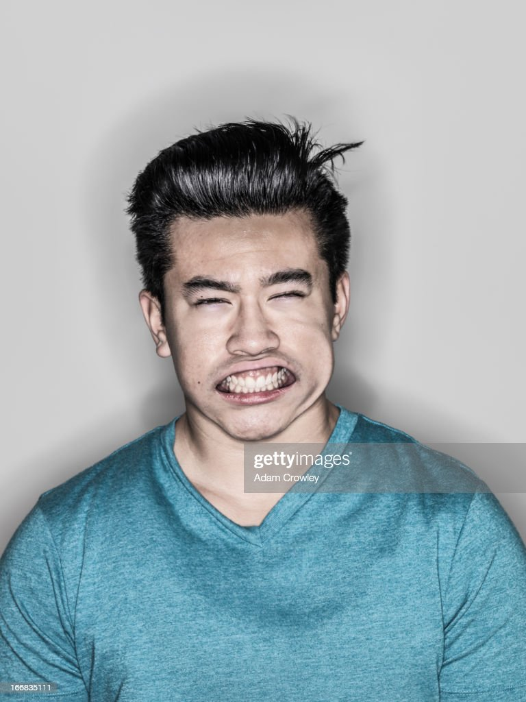 Man making face in wind : Stock Photo
