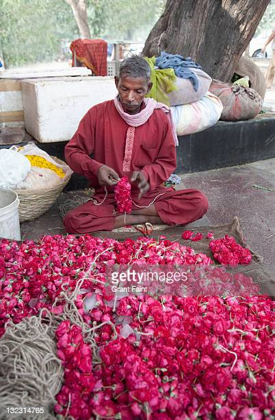Man making flower products.