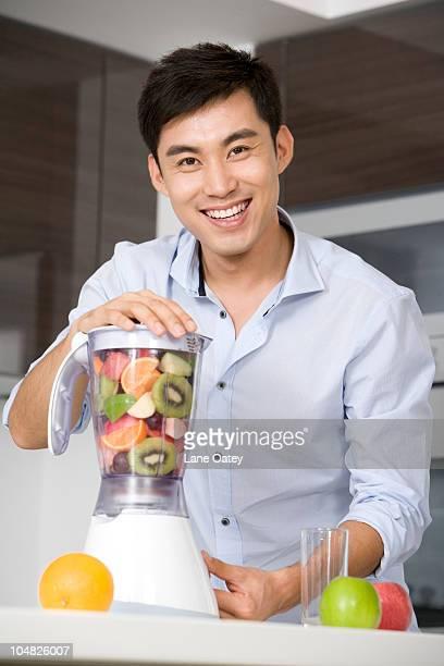 Man making fresh fruit juice