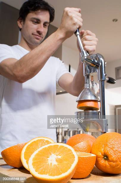 Man making fresh orange juice