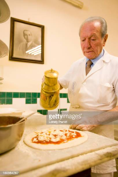 Man making Margeurita pizza at Da Michele Pizzeria, Centro Storico.