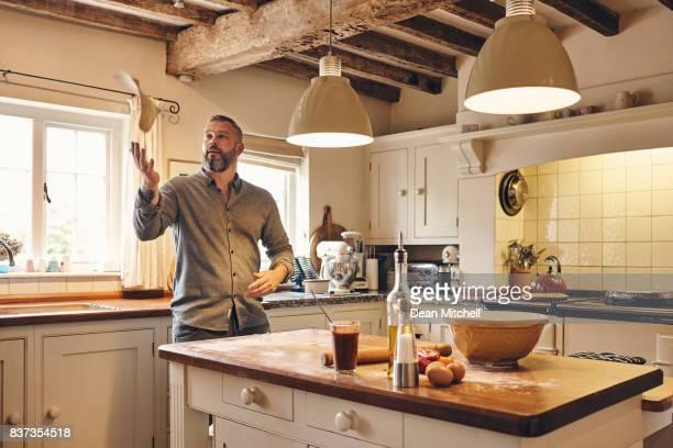 Man making pizza at home