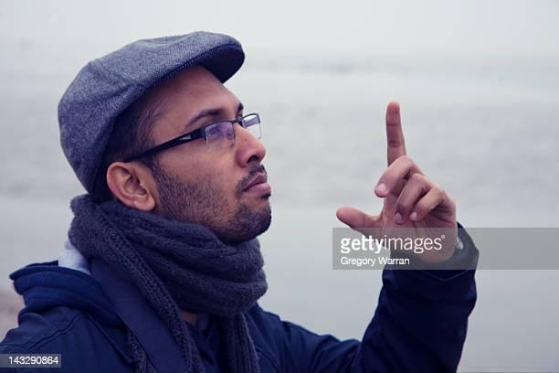 Man making pointing upwards