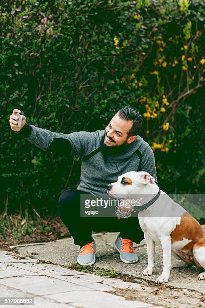 Man Making Selfie With His Dog Outdoors.